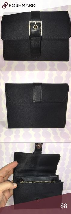 "NWOT Express Clutch Wallet Black sateen clutch wallet.  Rhinestone belt snap closure.  NWOT.  3 compartments, one zippered.  1 open pocket.  Express.  5.25"" wide, 4"" tall, 1.25"" deep.  Approximate. Accessories"
