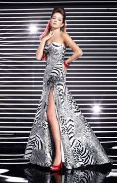 We are loving  this super chic and funky animal print drop waist.  This Prom dress comes in classic black and white and would look great paired with bright and fun accessories!  If you love Cheetah, leopard and zebra print, then this Studio 17 12283 Prom Dress is the dress for you!