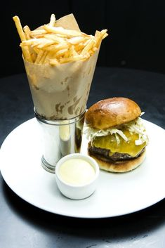 NYT Cooking: Michael David, the executive chef at Comme Ça brasserie in Los Angeles, gave this recipe to The Times in 2009 — a consummate burger that took him, he said, 11 tries to develop. The patties are seared on a plancha, stove-top cast-iron skillet, or grill, then finished either in the oven or the cooler side of a grill, with melted Cheddar and, at last, an iceberg lettuce salad dressed with spicy ma...