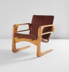 "KEM WEBER  ""Air Line"" armchair  designed 1934  Birch veneer, ash, naugahyde, steel.  31 x 24 1/2 x 35 in. (78.7 x 62.2 x 88.9 cm)  Manufactured by the Air Line Furniture Company, Los Angeles, California. Underside inscribed with paint 366."