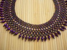 Beautiful multicolor purple (iris purple) color beadwork necklace. I used czech glass seed beads rondell and teardrop crystal beads for this necklace. Also used purple hematite gemstone tube beads The length of the necklace with clasp is 43 cm (16,93 in), width: 4 cm (1,57 in) This