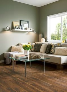 http://www.armstrong.com/flooring/how-to-install-laminate-flooring.html. I like the green walls and the casual, clean decor.
