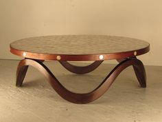 Remarkable 1940s Hollywood Regency Walnut and Capiz Shell Cocktail Table | From a unique collection of antique and modern coffee and cocktail tables at https://www.1stdibs.com/furniture/tables/coffee-tables-cocktail-tables/