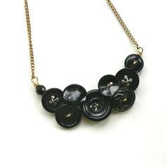 Black and Gold Vintage Button Necklace, Small Cluster of buttons with Gold Color Wire - Free Shipping. $24.00, via Etsy.