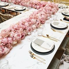 In love with this pink peony floral table runner and gold flatware. Gorgeous tablescape!