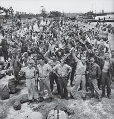 American troops in the Philippines celebrate the long-awaited news that Japan has, finally, unconditionally, surrendered in August 1945.