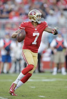 Quarterback Colin Kaepernick #7 of the San Francisco 49ers looks to pass during the first quarter of their game against the Chicago Bears at Levi's Stadium on September 14, 2014 in Santa Clara, California.