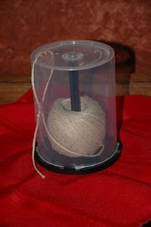 DIY garden twine dispenser from an old cd case.