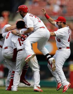 Peter Bourjos is congratulated by teammates after hitting a walkoff-single to score Yadier Molina during the ninth inning of a game against the Pirates, Sept. 3, 2014. The Cardinals won 1-0