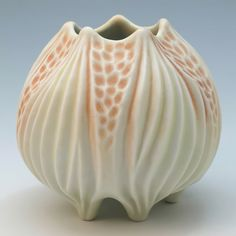 Carved porcelain pale yellow and orange squat vase - by Roberta Polfus...Has an old fashioned aspect to it...