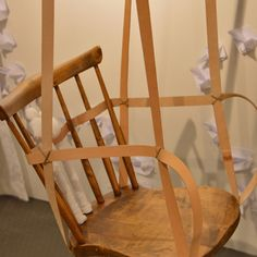 Recycle old wooden chairs to rocking chairs.