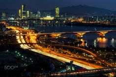 """A Seoul-ful Night - Always busy in Seoul :) Rush hour traffic viewed from haneul park in mapo province of Seoul. The view of seongsan bridge and yeouido park with the national assembly in the distance.  For Prints: </a> <a href=""""http://fineartamerica.com/featured/night-traffic-over-han-river-in-seoul-insung-choi.html"""">Fine Arts America</a> For more: aaron90311@gmail.com <a href=""""http://www.facebook.com/lifesolyrical""""> FB Page </a> <a href=""""http://www.aaronchoiphoto.com"""">Website</a> <a…"""