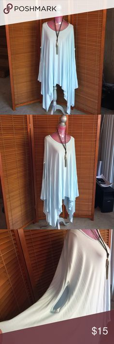 Armhole Poncho Refined yet relaxed Long and flowing  poncho drapes you in  comfort. Complete the look with your favorite legging and knee high boots.   95% rayon/ 5% spandex.  Excellent condition. Never Worn. Get it today, may be gone tomorrow. cherish Tops