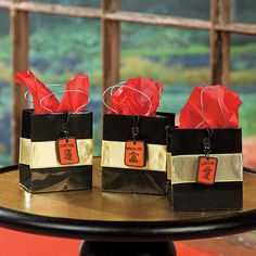 Celebrate a new year with these small favors. These Chinese New Year Mini Gift Bags are a perfect way to wish your guests good luck and good fortune in the . Spy Party, Party Themes, Theme Ideas, Ideas Party, Chinese Theme Parties, Chinese New Year Gifts, Mini Gift Bags, Ninja Party, New Years Party