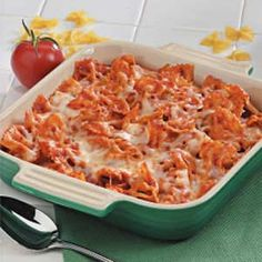 Italian bow tie bake  8 ounces uncooked bow tie pasta  2 cups garden-style spaghetti sauce  1 envelope Italian salad dressing mix  2 cups (8 ounces) shredded part-skim mozzarella cheese