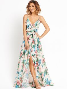 Myleene KlassFloral Print Ruffle Detail Maxi Dress Super girly and just as flirty, this floral print ruffle detail maxi dress by MyleenKlasshits refresh on your event edit! With a V-neckline spaghetti straps and split to the front, you flash a little flesh and show off your tan, while the maxi length keeps you chic too!Team with strappy heels and loose waves in your hair, completing your look with pastel nail polish and an embellished clutch.