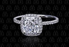 Halo engagement ring shown with a 2-carat Dynasty Cut cushion-cut diamond