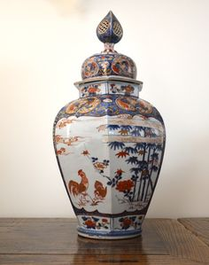 A Very Large Japanese Imari Porcelain Vase and Hollow Reticulated Domed Cover, Arita Kilns c.1690-1730. Finely Decorated in Bright Enamels and a Strong Deep Cobalt Blue with Pairs of Birds in Different Settings. They are a Cockerel and a Hen, A Pair of Mandarin Ducks (Representing marital faithfulness) Among Tall Rabbit-Ear Iris. A Pair of Peacock Among Prunus.