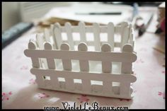 Popsicle stick picket fence ....would be very cute around an Easter display for the table