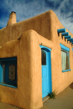 This is an adobe style house in Taos, New Mexico. This architeture is praised today for its unique construction. It is a clasic style construction.
