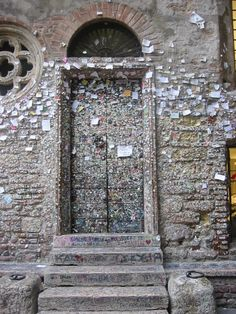 Verona holds the claim to having the houses of perhaps the greatest lovers in history. Casa di Giulietta, or Juliet's House, and the love notes of tourists plastered all over it. Verona, Italy.