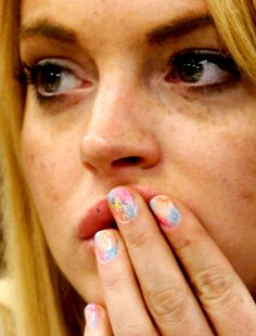 ysl india website - Lindsay Lohan wearing Yves Saint Laurent Belle de Jour Wristlet ...