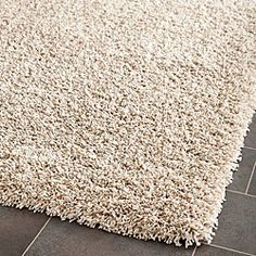 The one-inch pile height gives this plush beige shag rug both comfort and luxurious style. The neutral beige color makes it perfect for any room in the house. This casual style rug measures x and is perfect for any small living area. Solid Rugs, Thing 1, Vintage Trends, Square, Beige Color, My Living Room, Tent Living, Small Living, Living Area
