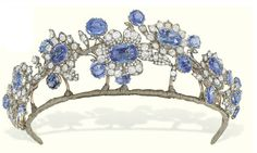 Christies AN ANTIQUE SAPPHIRE AND DIAMOND TIARA  The foliate wreath composed of seven graduated oval-shaped sapphire and old-cut diamond flowerheads applied on a rose-cut diamond branch with sapphire single-stone collet detail, mounted in silver and gold, circa 1850, 17.0 cm wide  The Barberini Jewels (lots 145-148) (from Christies auction site)