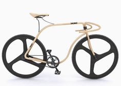 a wooden road bicycle for Thonet using the same steam-bending process the company employs in its classic coffee house and rocking chairs.