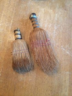 Two simple hand brooms