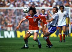 England 3 France 1 in 1982 in Bilbao. Paul Mariner wins this challenge at San Mames at the World Cup Finals, group match. England Vs France, Paul Mariner, England Football Players, Ipswich Town Fc, 1982 World Cup, Michel Platini, International Football, England International, Football Uniforms