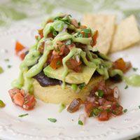 Chipotle polenta cakes with beans, salsa fresca, and avocado crema