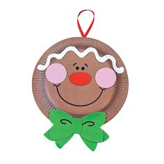 Paper Plate Gingerbread Man Craft Kit - OrientalTrading.com {Simple to recreate without having to buy the kit} *paper plates (painted brown) *foam sheets or construction paper or stray fabric pieces (like for the bow) *sharpie marker *elmers or craft glue *ribbon