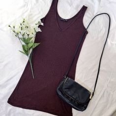 "Burgundy Striped Body Dress (by Brandy Melville) I bought this dress in burgundy striped and another one in grey, but never ended up wearing this burgundy colored one! so it is in EXCELLENT condition; one sizes fits all! it is super stretchy AND soft so dress fits sizes S-M (12"" inches wide & 28"" inches long, keep in mind that it is a very stretchy but soft material). Any questions? leave a comment below ⬇️ Brandy Melville Dresses Mini"