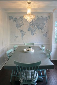 This dining room oozes rustic french country decor. I love the decadent yet pared-down feel of this room, the pale blue hues of the dining furniture match perfectly with our blue World map mural.