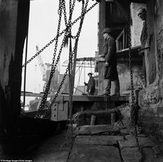 Men working at WN Sparks & Sons, a wharf on the River Thames in Narrow Street, Limehouse, The chains are used for mooring ships or as part of pulleys for loading and unloading. A crane can be seen in the background London History, British History, Asian History, Tudor History, East End London, Old London, London Docklands, Concrete Sculpture, Steampunk