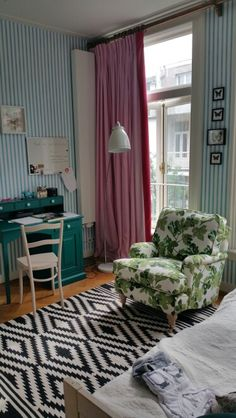 My daughters new room. Love Peter Dunham fig leaf chair. Blue stripe wallpaper
