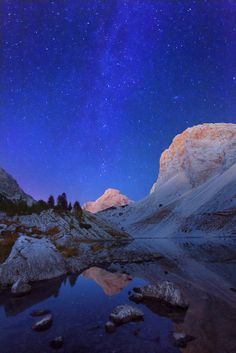 Milky Way on night sky above the Big lake in Triglav lakes valley high in the Jilian Alps.