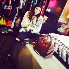 Kourtney Kardashian wins at Instagram by posing with her Givenchy handbag and cute cat. www.handbag.com