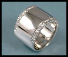 Thick band add a single stone set up in the middle !
