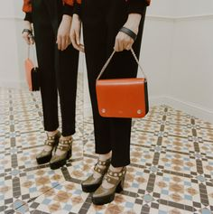 Mulberry: The New Campaign. Self/Reflection featuring the Clifton in Bright Orange.