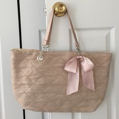 NWOT Adorable pale pink bag with bow NWOT Adorable pale pink bag with bow. Inside has 2 pockets and a zipper. Bags Totes