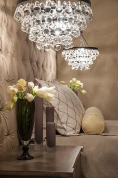Gorgeous Pendant lights replace space eating bedroom table lamps.