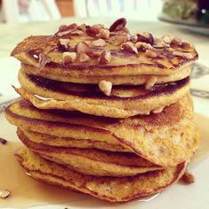 pumpkin spice pancakes topped with sugar free syrup and chopped pecans