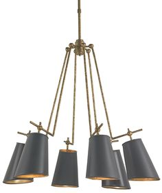 Wrought iron and sheet metal form this classic task light. Shades are hand-finished with Marbella Black while the interior of the shade exudes a warm reflection from the Contemporary Gold Leaf. The Je