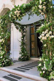 Lots of greenery with pops of flowers, either in all white or in the colors of the wedding: coral, blue, etc.