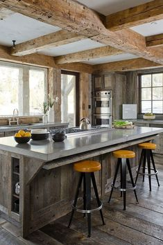 Modern rustic bar in contemporary lodge kitchen.  Love the rough hewn beams.
