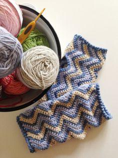chevron wrist warmers and bowl of yarn.
