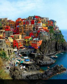 Cinque Terra, Italy It's real, and really beautiful. I want to visit there someday
