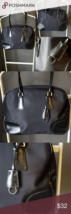 NINE WEST Large Laptop or Business Portfolio Nine West black nylon and vagan leather laptop bag or can be used as a business portfolio.  Stylish and easy to clean has an attached key holder and TONS of storage space Nine West Bags Laptop Bags